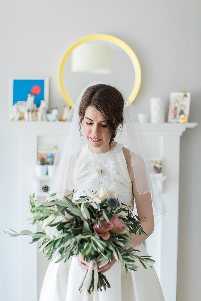 bright photo of a bride holding a bouquet