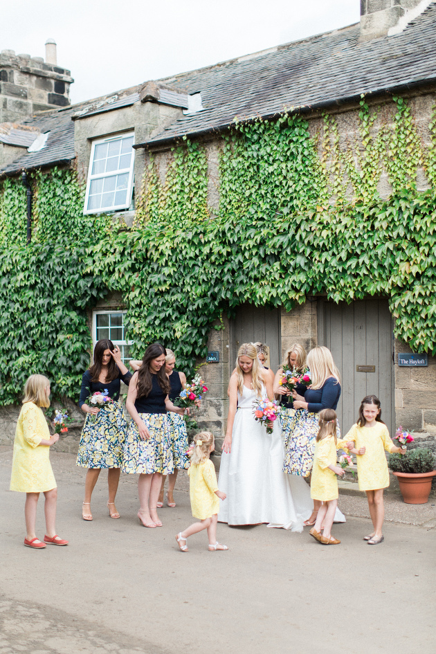 Doxford Barns wedding photography bridesmaids walk to the threshing hall